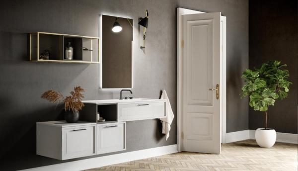 Meuble de salle de bains installé de façon asymétrique avec poignées