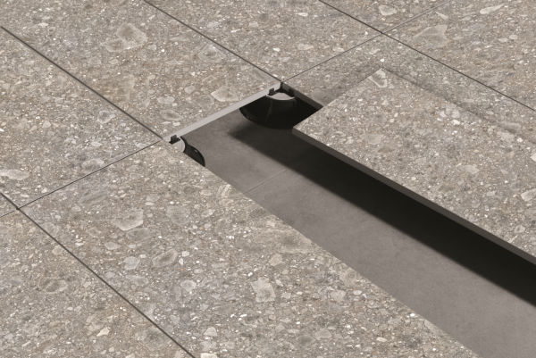 Carrelage de terrasse extérieur en imitation pierre posé sur plot