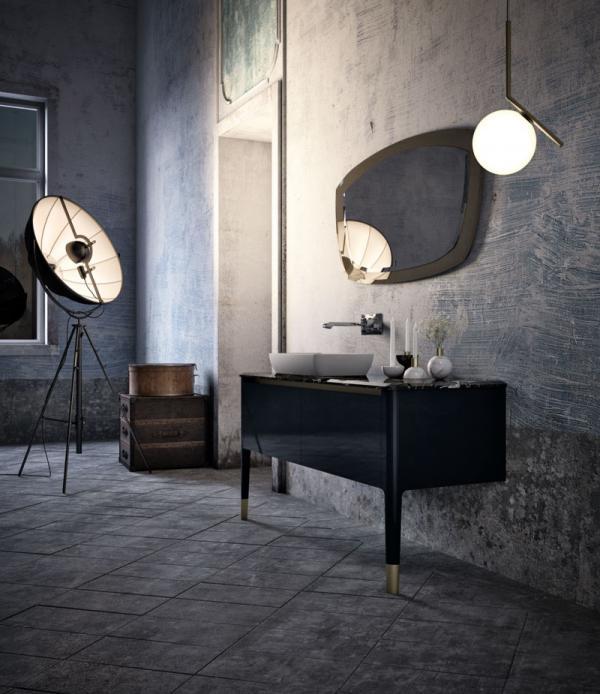 Meuble de salle de bains noir avec des finitions en laiton  et or