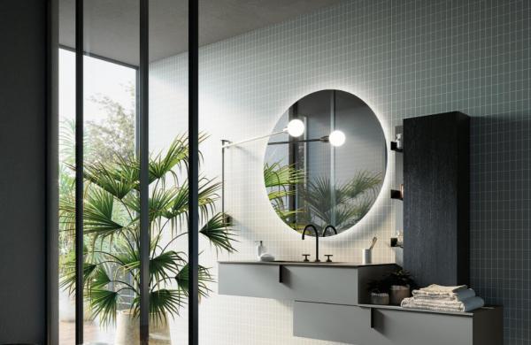 Meuble de salle de bains tendance bleu posé avec un décalage